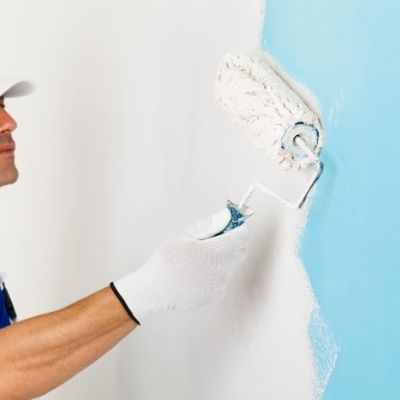 Melton painters - Nick painting a wall